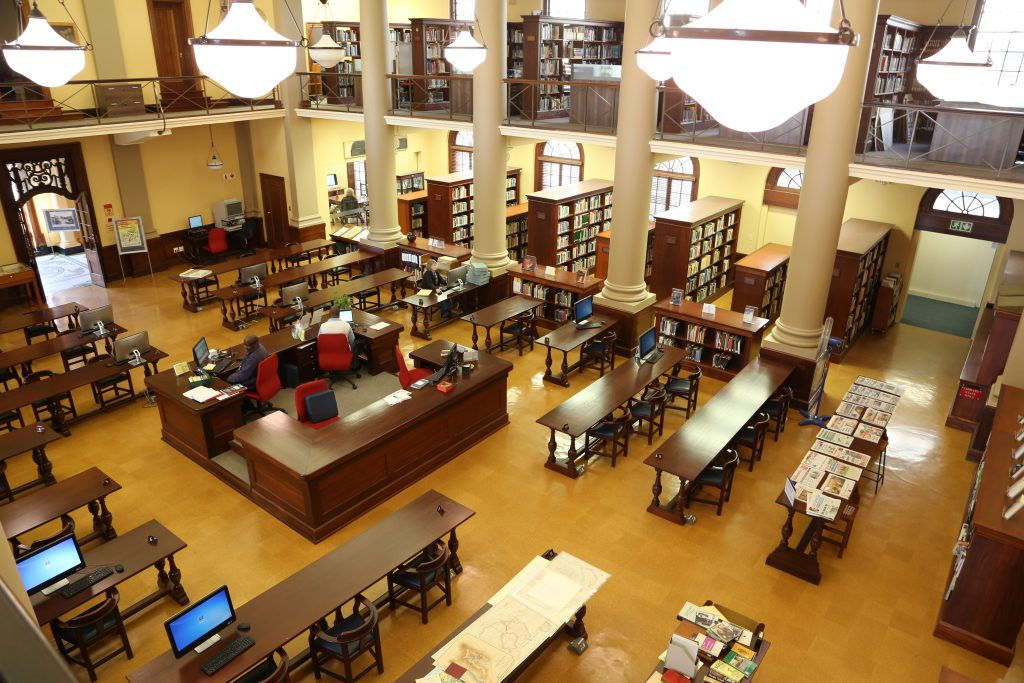 The restoredReading Room of the JW Jagger Building showing desks, shelves, computers, etc.