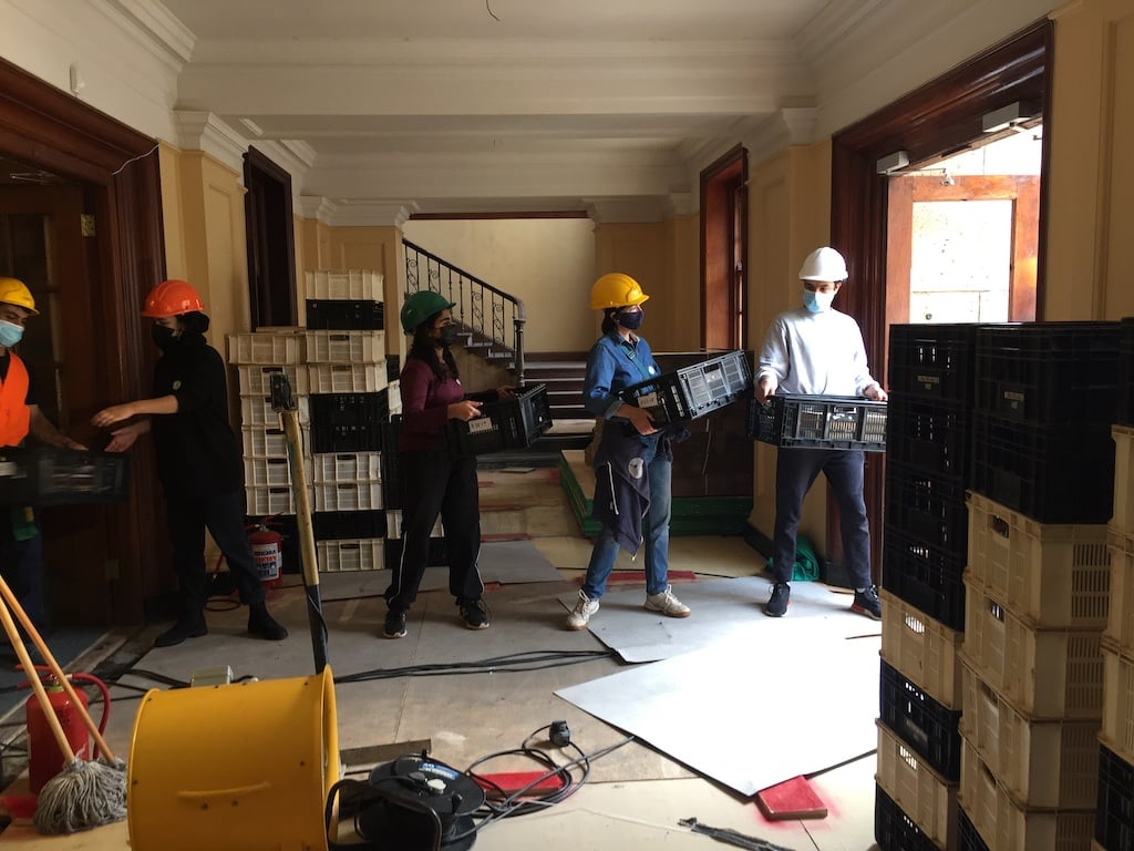 Staff and volunteers removing material from the Jagger Store.