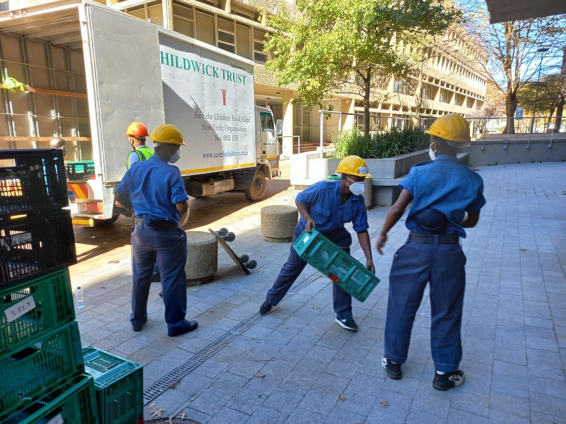 Sea Cadets unloading crates from the truck.